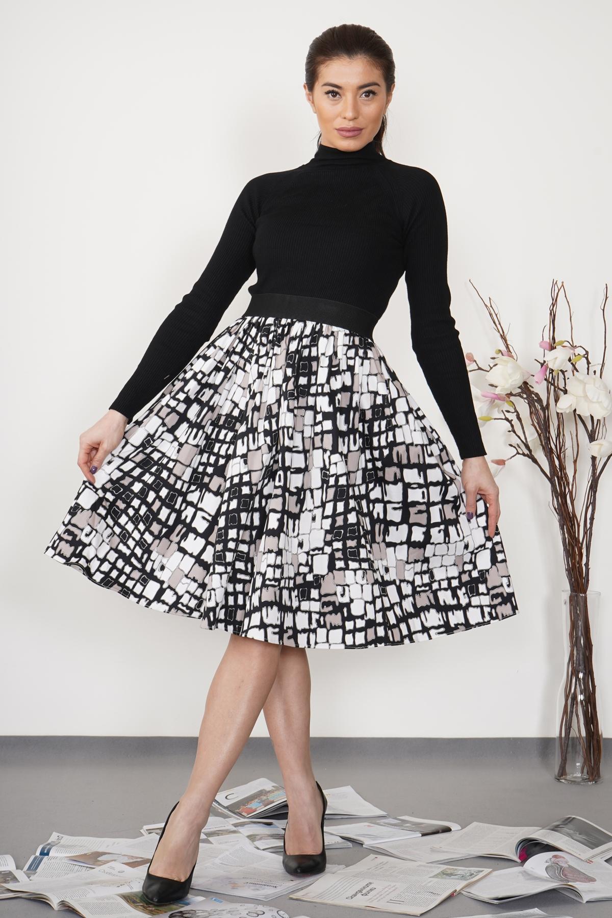 Дамска пола в черно и бяло с черен ластик на талията